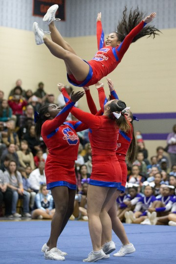 Centennial competes during of the Howard County Cheerleading Championships at Long Reach High School in Columbia.