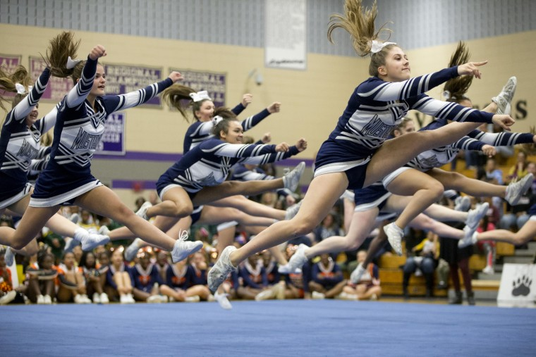 Marriotts Ridge cheerleaders compete during the Howard County Cheerleading Championships at Long Reach High School in Columbia.