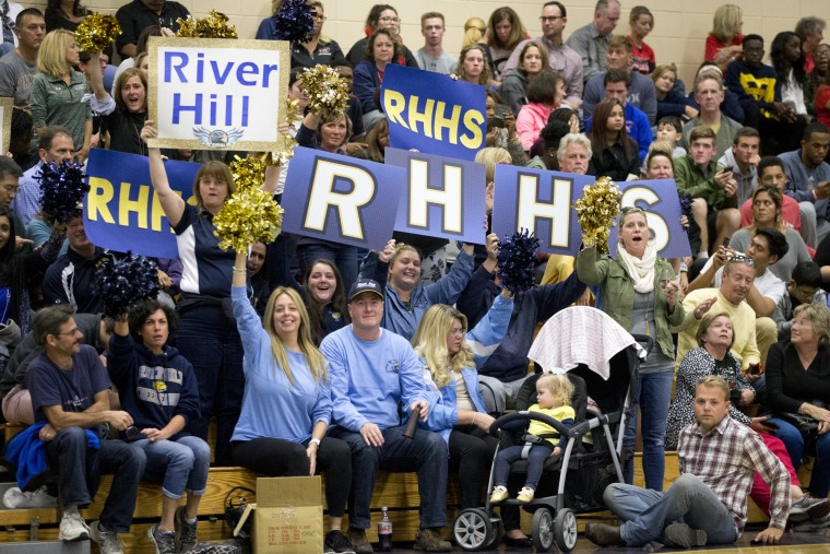 River Hill fans cheer during the Howard County Cheerleading Championships at Long Reach High School in Columbia.