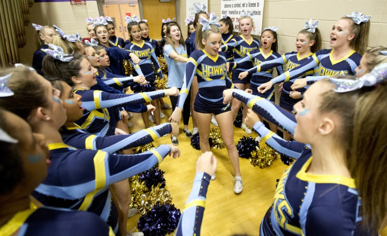 River Hill cheerleaders gather around Dare McLaughlin, 16, before they compete during the Howard County Cheerleading Championships at Long Reach High School in Columbia.