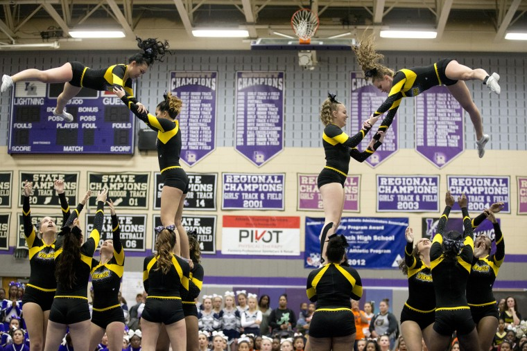 Mt. Hebron cheerleaders compete during the Howard County Cheerleading Championships at Long Reach High School in Columbia.