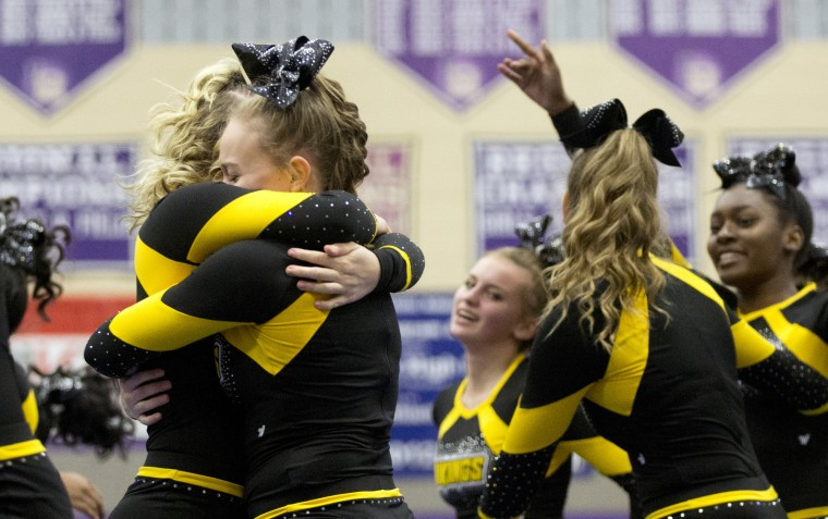 Mt. Hebron's Emily Weller, left, 16, and Sophie Bronow, right, 17, hug after competing during the Howard County Cheerleading Championships at Long Reach High School in Columbia.