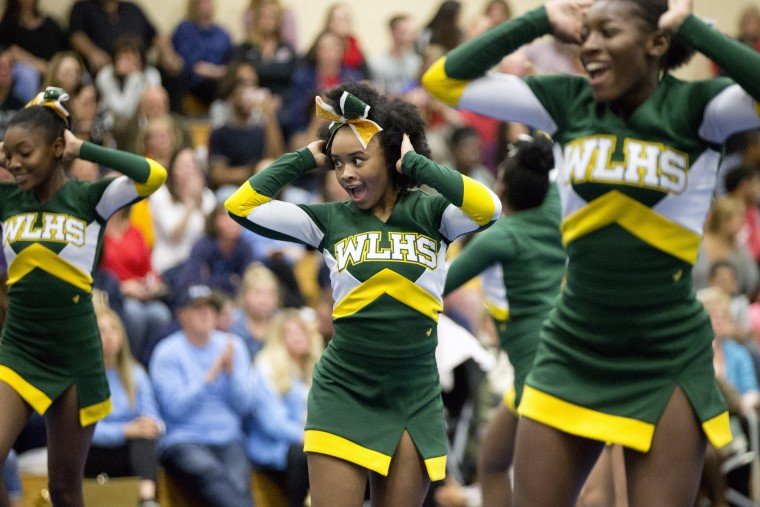Wilde Lake cheerleaders compete including Dashae Coley-Epps, center, 17, during the Howard County Cheerleading Championships at Long Reach High School in Columbia.