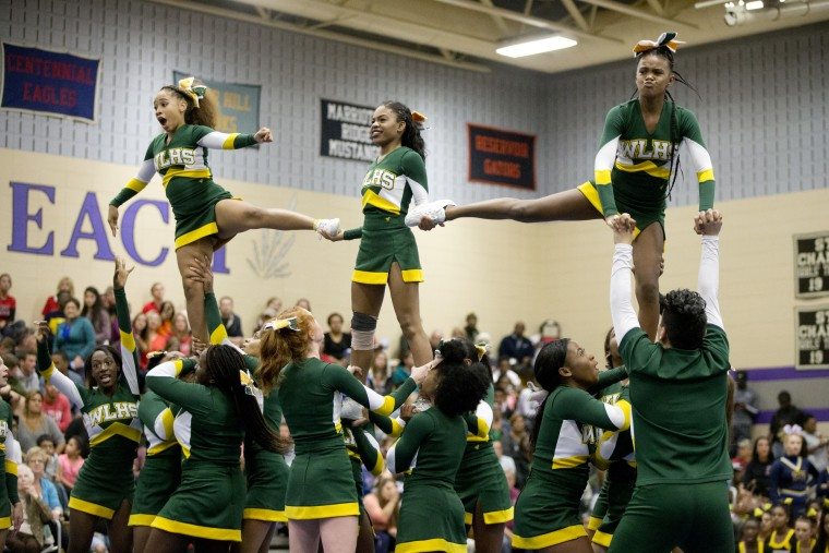 Wilde Lake competes during the Howard County Cheerleading Championships at Long Reach High School in Columbia.