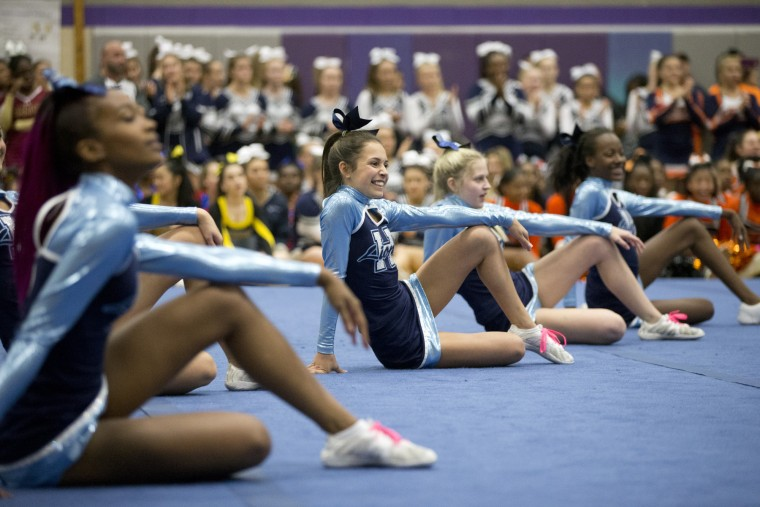 Howard competes in the Howard County Cheerleading Championships at Long Reach High School in Columbia.