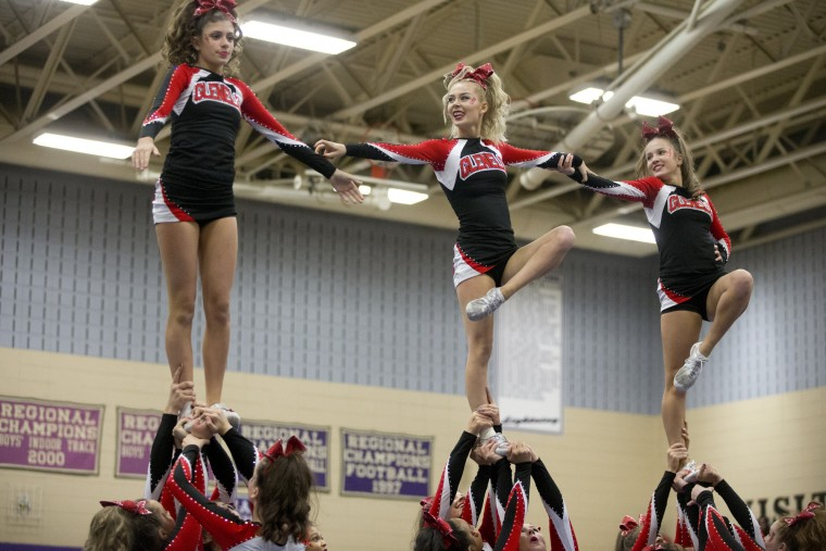 Glenelg competes during the Howard County Cheerleading Championships at Long Reach High School in Columbia.