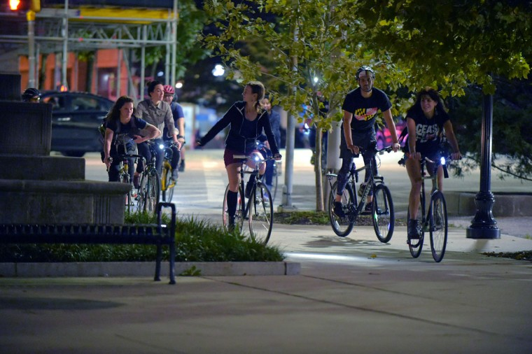The bicyclists arrive at City Hall, on a bike run recognizing the second Baltimore Cease Fire weekend. (Karl Merton Ferron / Baltimore Sun Staff)