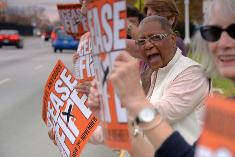 "Dorothea Powe of Edmondson Village loses her voice, shouting, ""Cease the fire!"" during the second Baltimore Cease Fire weekend, held at Edmondson Village Shopping Center. (Karl Merton Ferron / Baltimore Sun Staff)"