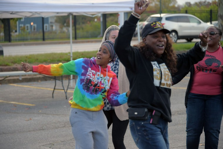 Ellen Gee (left), Tammy Warner (background) and Jai Joyce (right) flash mob dance at Edmondson Village Shopping Center, during the second Baltimore Cease Fire weekend. (Karl Merton Ferron / Baltimore Sun Staff)