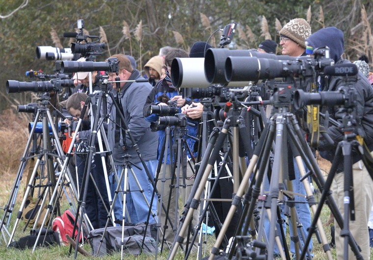 Photographers, including news media and participants in NASA Social, a program where the agency engages with active social media users  to cover NASA events, line up at the press viewing site, about two miles from the launch pad, to photograph the launch. (Dylan Slagle/Baltimore Sun Media Group)