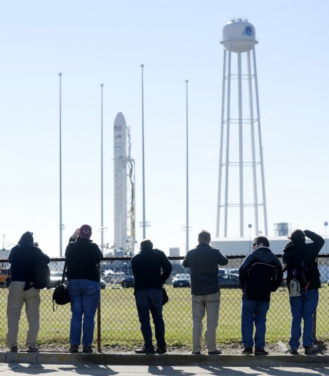 Photographers take photos of the Antares launch vehicle during a tour of the launch site Friday, Nov. 10, 2017. (Dylan Slagle/Baltimore Sun Media Group)