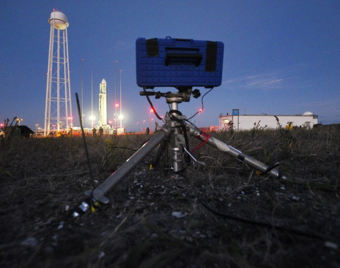 A modified toolbox, mounted on a tripod, serves as a protective housing for a digital still camera, GoPro video camera and electronics to photograph the launch remotely from about 200 yards from the launchpad. (Dylan Slagle/Baltimore Sun Media Group)