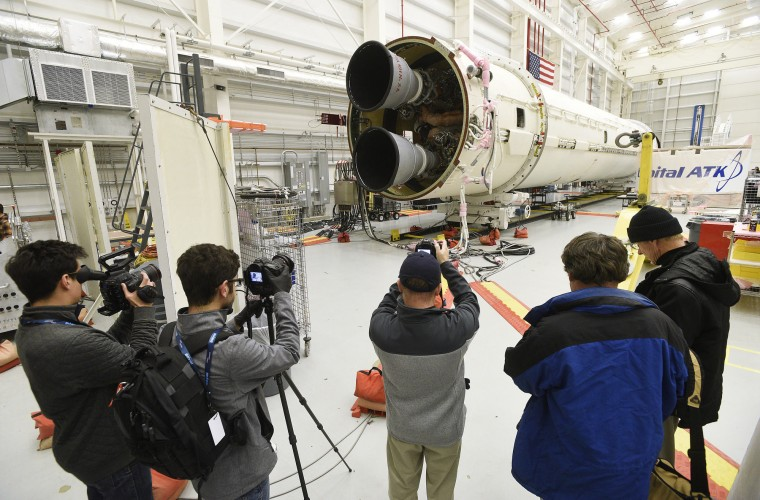 News media photograph an Antares launch vehicle during a tour of the Horizontal Integration Facility at the launch site, where final assembly of the vehicles takes place, Friday, Nov. 10, 2017. (Dylan Slagle/Baltimore Sun Media Group)