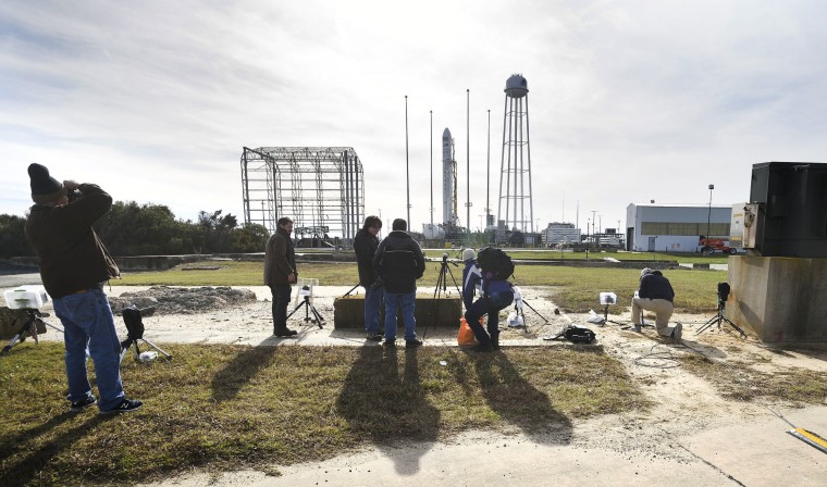News photographers check on their remote camera setups of the North side of the launch pad Saturday afternoon, following a scrubbed launch attempt earlier that morning. (Dylan Slagle/Baltimore Sun Media Group)