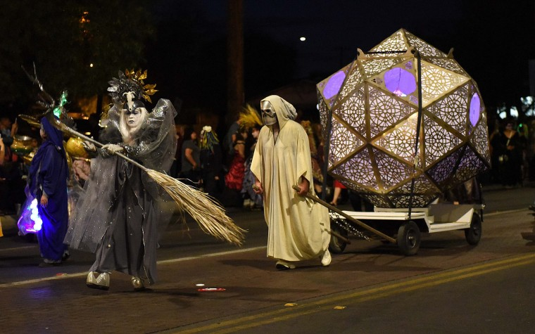The Urn containing notes with the hopes, offerings and wishes for those who have passed is pulled during Tucson's All Souls Procession The event meant to both celebrate and mourn the lives of those lost. It culminates with the ceremonial burning of the Urn. (Jerry Jackson/Baltimore Sun)