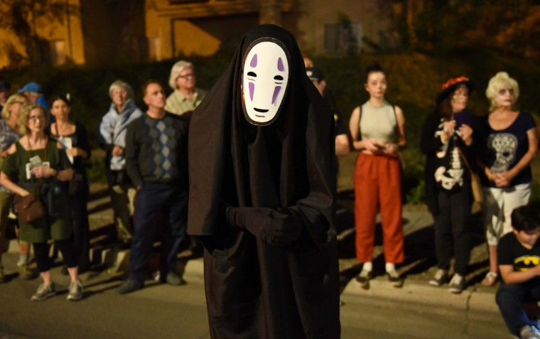 A reveler wearing a No-Face costume from Japanese anime participates in Tucson's All Souls Procession. (Jerry Jackson/Baltimore Sun)