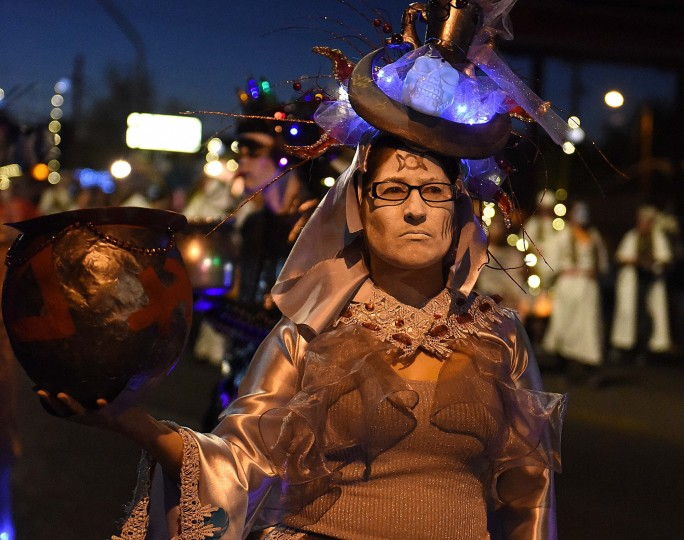 An Urn Ambassador collects notes to put in the urn during the 2017 All Souls Procession in Tucson. The Procession is an event meant to both celebrate and mourn the lives of those lost. (Jerry Jackson/Baltimore Sun)