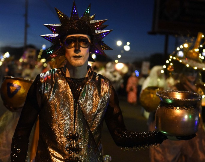 Urn ambassador Nick Tomazic collects notes to put in the urn during the 2017 All Souls Procession in Tucson. The Procession is an event meant to both celebrate and mourn the lives of those lost. (Jerry Jackson/Baltimore Sun)