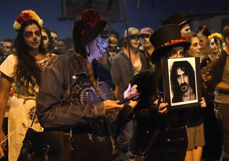 A participant carries a photo of Frank Zappa during the All Souls Procession in Tucson. The event meant to both celebrate and mourn the lives of those lost. (Jerry Jackson/Baltimore Sun)