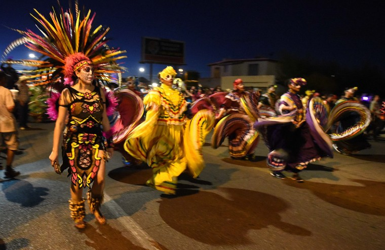 Dancer perform during Tucson's All Souls Procession Sunday. (Jerry Jackson/Baltimore Sun)