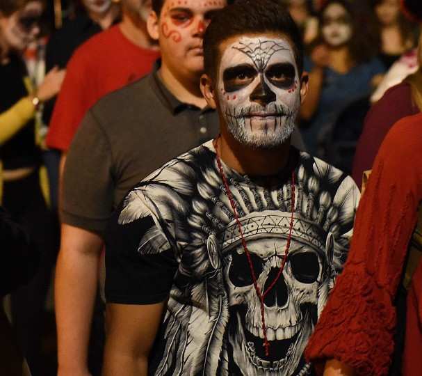 Many participants in Tucson's All Souls Procession have their faces painted to resemble stylized skulls or claviera. (Jerry Jackson/Baltimore Sun)