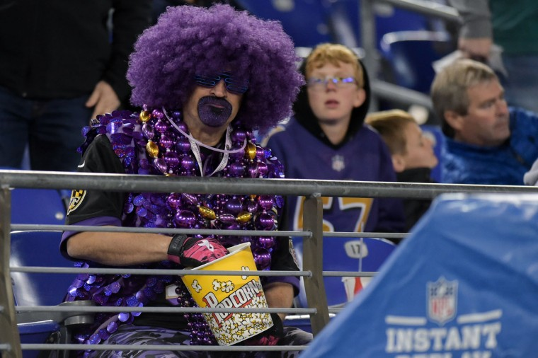 The stadium wasn't sold out but plenty of fans, like this who were there went all out with their outfits. (Ulysses Munoz/Baltimore Sun)