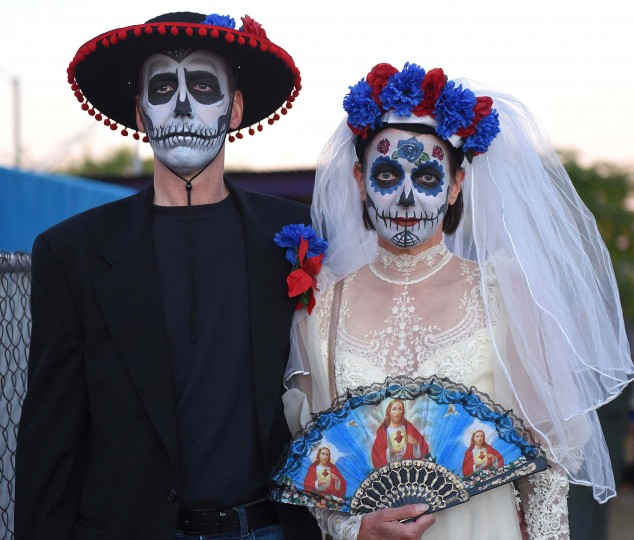A couple dressed as a calavera bride and groom for Tucson's All Souls Procession.  (Jerry Jackson/Baltimore Sun)
