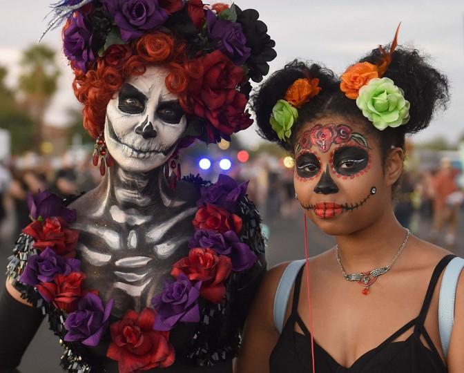 Many participants in Tucson's All Souls Procession have their faces painted to resemble stylized skulls or calavera. (Jerry Jackson/Baltimore Sun)