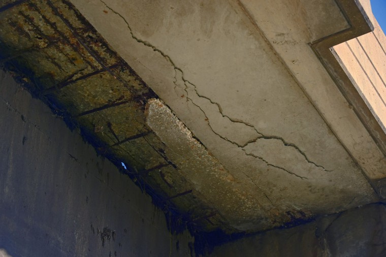 Crumbling concrete exposes rusted rebar and a hole to the bridge deck above in a study of the Vietnam Veterans Memorial Bridge, known by many as the Hanover Street Bridge, which links Baltimore and Port Covington with Cherry Hill, Brooklyn and Curtis Bay. (Karl Merton Ferron / Baltimore Sun)