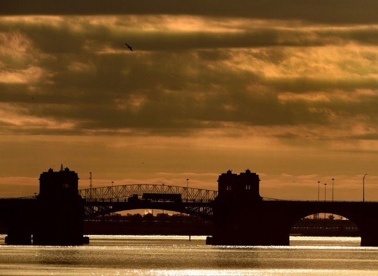 The Francis Scott Key Bridge span appears to be a part of the Vietnam Veterans Memorial Bridge as a truck heads toward the city in the morning. Known by many as the Hanover Street Bridge, it links Baltimore and Port Covington with Cherry Hill, Brooklyn and Curtis Bay. (Karl Merton Ferron / Baltimore Sun)