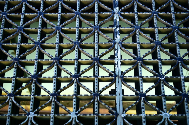 Looking down to the girders below, steel grates on the double leaf show wear from traffic. (Karl Merton Ferron / Baltimore Sun)