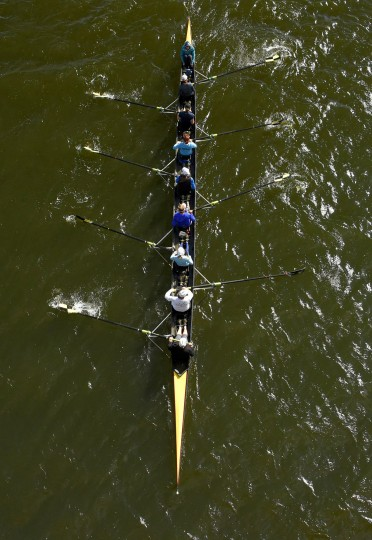 Rowers practice below the Vietnam Veterans Memorial Bridge, known by many as the Hanover Street Bridge. (Karl Merton Ferron / Baltimore Sun)