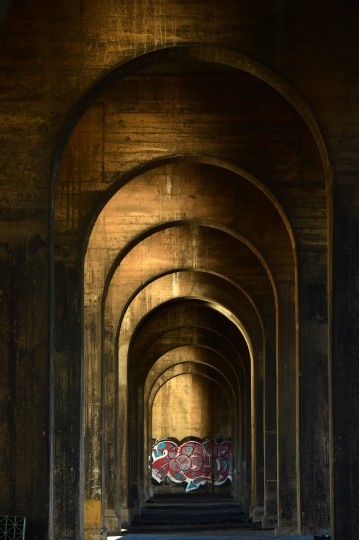 Arches beneath the deck are illuminated in afternoon sun looking north in a study of the Vietnam Veterans Memorial Bridge, known by many as the Hanover Street Bridge, which links Baltimore and Port Covington with Cherry Hill, Brooklyn and Curtis Bay. (Karl Merton Ferron / Baltimore Sun)