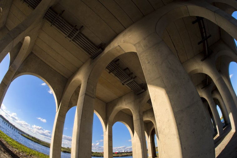 Arches support the bridge deck in a view looking west in a study of the Vietnam Veterans Memorial Bridge, known by many as the Hanover Street Bridge, which links Baltimore and Port Covington with Cherry Hill, Brooklyn and Curtis Bay. (Karl Merton Ferron / Baltimore Sun)
