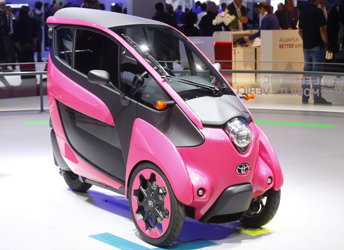 a three wheel design and ultra compact toyota i road electric car is displayed on media day at. Black Bedroom Furniture Sets. Home Design Ideas
