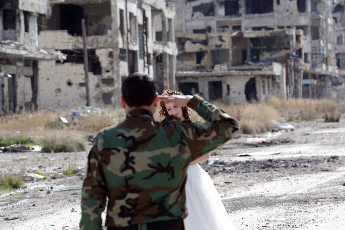 Wedding photos capture love amid destruction in war-torn Syria