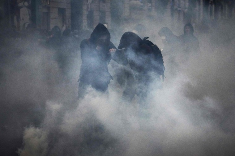 Protesters clash with police during a demonstration on March 9, 2016, in Lyon, central-eastern France, as part of a nationwide day of protest against proposed labour reforms. France faced a wave of protests on March 9 against deeply unpopular labour reforms that have divided an already-fractured Socialist government and raised hackles in a country accustomed to iron-clad job security. (AFP / Jean-Philippe Ksiazek)