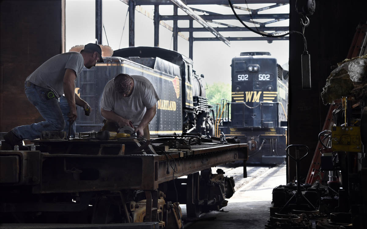 Bruce Snyder, left, mechanic, and Scott Nixon, right, shop foreman, work on  the tender frame of the C&O railroad 1309 steam locomotive at the Western  ...