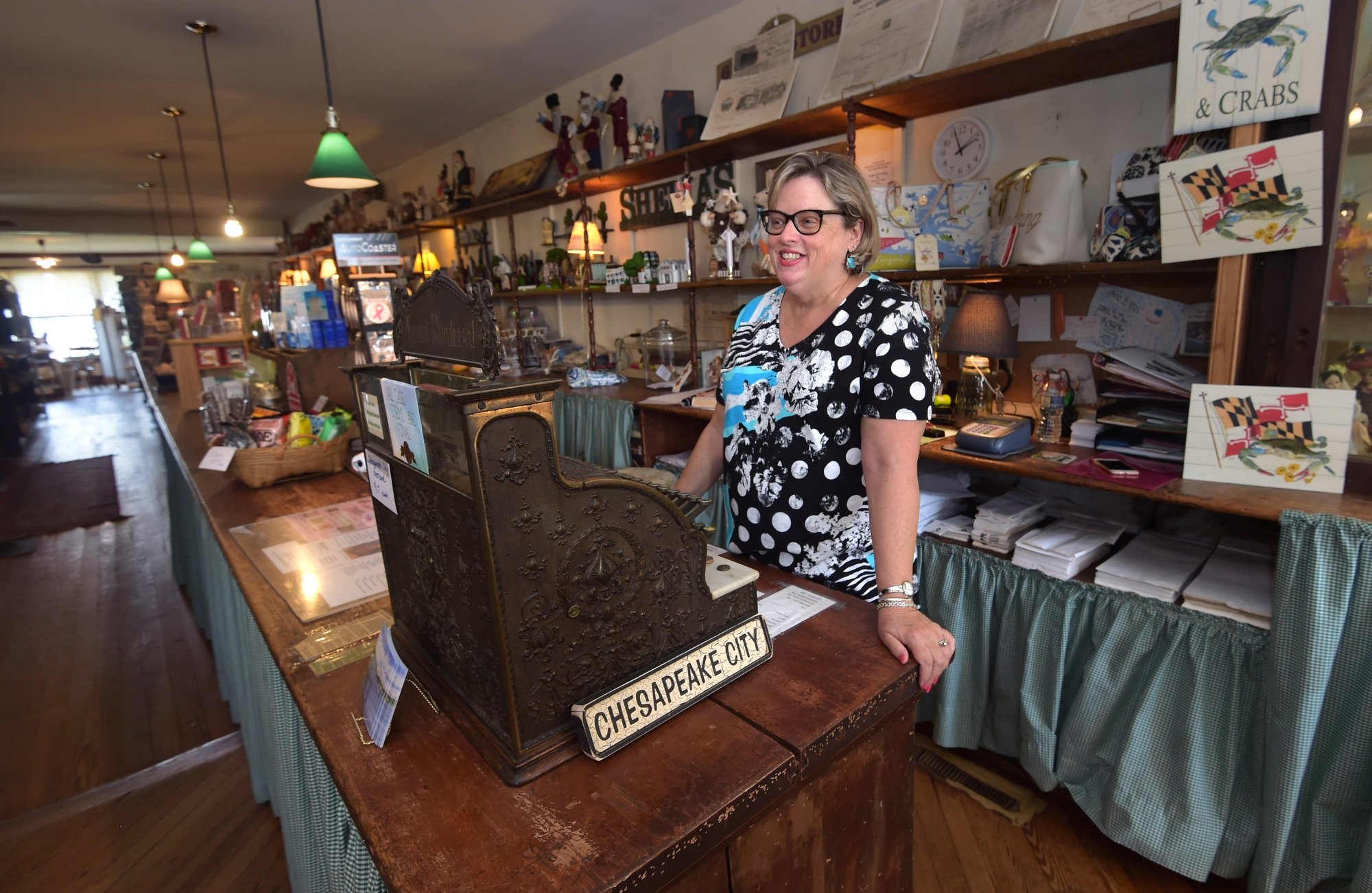 katie mcdonough hutton is pictured in back creek general store in the j m reed jr building. Black Bedroom Furniture Sets. Home Design Ideas